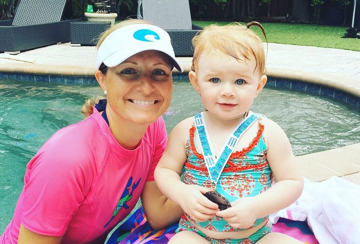 Audrey(1 year old) swim/float/swim the length of pool. Getting her swim medal